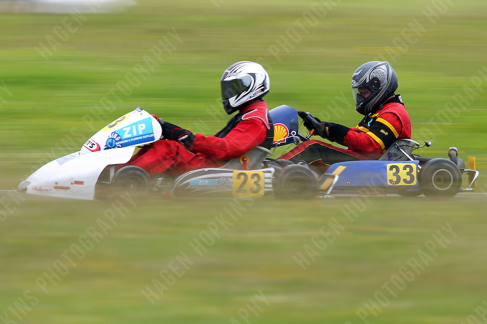 Clayton Merz, 23, and Sean Cuthbert, 33, race in the Rotax Heavy class during the 2012 Superkart National Champs and Grand Prix at Manfeild in Feilding, New Zealand on Saturday, 7 January 2011. Credit: Hagen Hopkins.