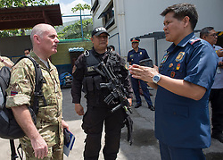 Image shows Lieutenant Colonel Harry Walker  talking to Police Senior Superintendent Jose Santiago Hidalgo Jr. (right.)<br /> <br /> Members of 77 Brigade on Exercise Civil Bridge 14A today visited the Philippine National Police offices &amp; The Rescue Emergency Disaster Training Facility, City of Pasig in Manila to discuss their earthquake contingency plans.<br /> 24/04/2015<br /> <br /> Credit should read: Cpl Mark Larner RY<br /> <br /> Exercise Civil Bridge is being conducted by elements of 77 Brigade &ndash; a specialist British military unit that is working alongside the government and disaster relief organisations as part of an annual overseas training exercise. <br /> <br /> Their mission during the two-week deployment will be to look at examples of the existing Philippine earthquake contingency response plans and, working with Philippine colleagues, make suggestions that will help save lives by enhancing the country&rsquo;s ability to respond to an earthquake in an urban setting.