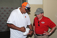 Former Cincinnati Bengal Anthony Munoz signs a football for Mike Sipple, Sr, of Latonia, Kentucky during the All Pro Dad Father & Kids NFL Experience at Welcome Stadium, Saturday, June 18, 2016.