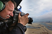 Nederland, Zuid-Holland, Rotterdam, 13-05-20011; fotograaf Ed Burtynsky maakt luchtfoto van de Tweede Maasvlakte in het kader van zijn project 'Water'..Photographer Ed Burtynsky makes aerial view of the Maasvlakte for his project 'Water '..luchtfoto (toeslag), aerial photo (additional fee required).foto/photo Siebe Swart