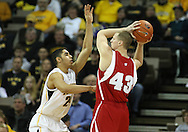 21 JANUARY 2009: Iowa's Aaron Fuller (24) defends Wisconsin's Kevin Gullikson (43) during the first half of an NCAA college basketball game Wednesday, Jan. 21, 2009, at Carver-Hawkeye Arena in Iowa City, Iowa. Iowa defeated Wisconsin 73-69 in overtime.