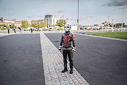 UNITED KINGDOM, London: 25 October 2015. <br /> Comic Con Feature.<br /> A young boy waits for his parents near a car park outside of the ExCel Arena on the final day of the MCM London Comic Con.<br /> Photo: Rick Findler / Story Picture Agency