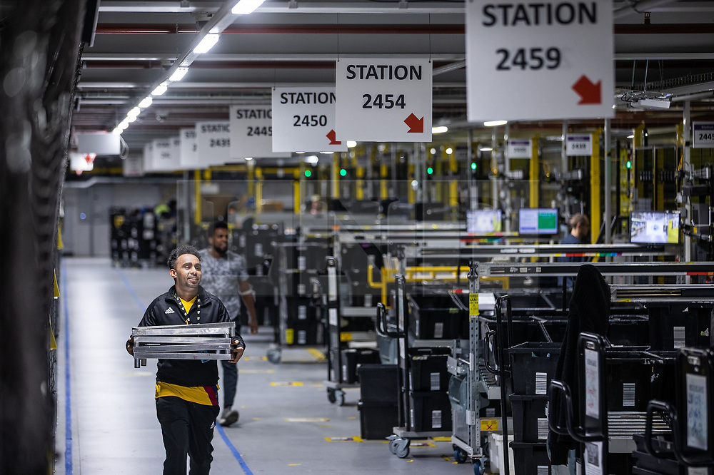 """© Licensed to London News Pictures . 04/12/2019. Manchester , UK . Inside the """"MAN1"""" Amazon fulfilment centre warehouse at Manchester Airport in the North West of England . Photo credit : Joel Goodman/LNP"""