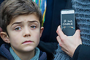 Charles aged 9 - Je suis Charlie/I am Charlie - A largely silent (with the occasional rendition of the Marseileus)gathering in solidarity with the march in Paris today.  Trafalgar Square, London, UK 11 Jan 2015Guy Bell, 07771 786236, guy@gbphotos.com