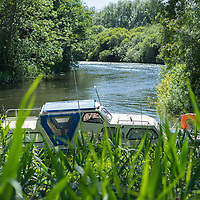 A small pleasure craft on the river at Bungay in Suffolk England