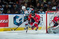 KELOWNA, CANADA - APRIL 8: Nick Merkley #10 of the Kelowna Rockets gains possession of the puck after checking Caleb Jones #3 of the Portland Winterhawks behind the net during second period on April 8, 2017 at Prospera Place in Kelowna, British Columbia, Canada.  (Photo by Marissa Baecker/Shoot the Breeze)  *** Local Caption ***