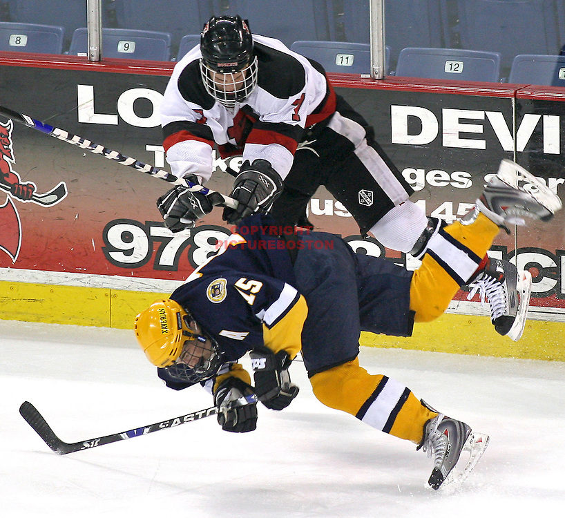 "(03/12/08-Lowell,MA) Xaverian vs Reading hockey ""Super 8"" semifinals..Xaverian's Andrew White (bottom) is hit by Reading's Travis Busch."