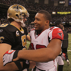 2008 December, 07: New Orleans Saints quarterback Drew Brees (9) and Atlanta Falcons running back Michael Turner (33) both former teammates with the San Diego Chargers greet each other following a 29-25 victory by the New Orleans Saints over NFC South divisional rivals the Atlanta Falcons at the Louisiana Superdome in New Orleans, LA.