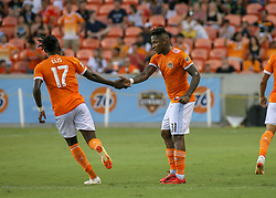 July 18, 2018 - Houston, TX, U.S. - HOUSTON, TX - JULY 18:  Houston Dynamo forward Alberth Elis (17) congratulates Houston Dynamo forward Romell Quioto (31) for scoring a goal during the US Open Cup Quarterfinal soccer match between Sporting KC and Houston Dynamo on July 18, 2018 at BBVA Compass Stadium in Houston, Texas. (Photo by Leslie Plaza Johnson/Icon Sportswire) (Credit Image: © Leslie Plaza Johnson/Icon SMI via ZUMA Press)