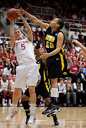 March 22, 2010; Stanford, CA, USA;  Iowa Hawkeyes forward Gabby Machado (50) blocks a shot by Stanford Cardinal forward Michelle Harrison (5) during the second half in the second round of the 2010 NCAA womens basketball tournament at Maples Pavilion. Stanford defeated Iowa 96-67.