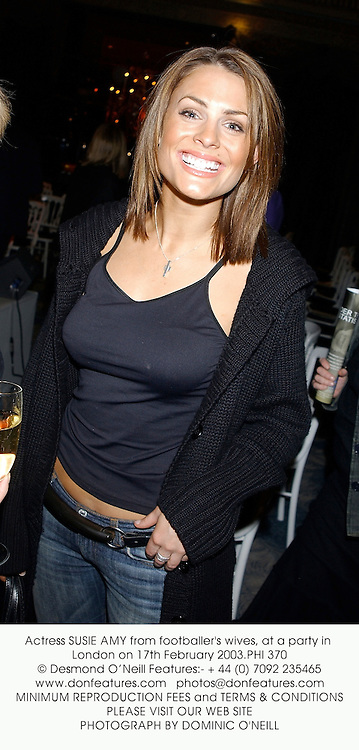 Actress SUSIE AMY from footballer's wives, at a party in London on 17th February 2003.PHI 370
