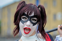 © Licensed to London News Pictures. 28/05/2017. London, UK. A girl dressed as Harley Quin from DC Comics at MCM Comic Con taking place at Excel in East London.  The three day event celebrates popular comic books, anime, games, television and movies.  Many attendees take the opportunity to dress as their favourite characters.    Photo credit : Stephen Chung/LNP