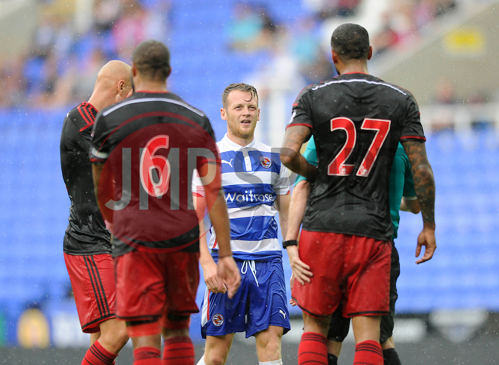 Reading's Chris Gunter argues with Swansea City's Kyle Bartley - Photo mandatory by-line: Dougie Allward/JMP - Mobile: 07966 386802 02/08/2014 - SPORT - FOOTBALL - Reading - Madejski Stadium - Reading v Swansea - Pre-Season Friendly