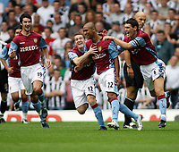 Photo: Rich Eaton.<br /> <br /> Aston Villa v Newcastle United. The Barclays Premiership. 27/08/2006. Luke Moore #22 is congratulated by teammates after scoring the opening goal of the game for Villa