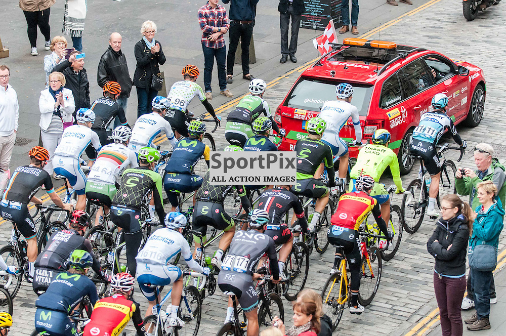 Riders including Britain's Mark Cavendish (11) follow the Race Controller's car along during the neutralised section along Edinburgh's famous Royal Mile. Action from Stage 4 of the Aviva Tour of Britain, 9 September 2015. (c) Paul J Roberts / Sportpix.org.uk