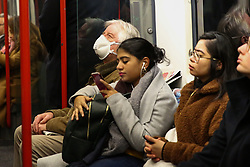 © Licensed to London News Pictures. 04/03/2020. London, UK. A passenger with a protective face mask travels on the Central line. Fifty one people have tested positive of Coronavirus (Covid-19) in the UK. Photo credit: Dinendra Haria/LNP