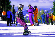 Young girl snowboarding. Silver Mountain Ski Area, Kellog, north Idaho.
