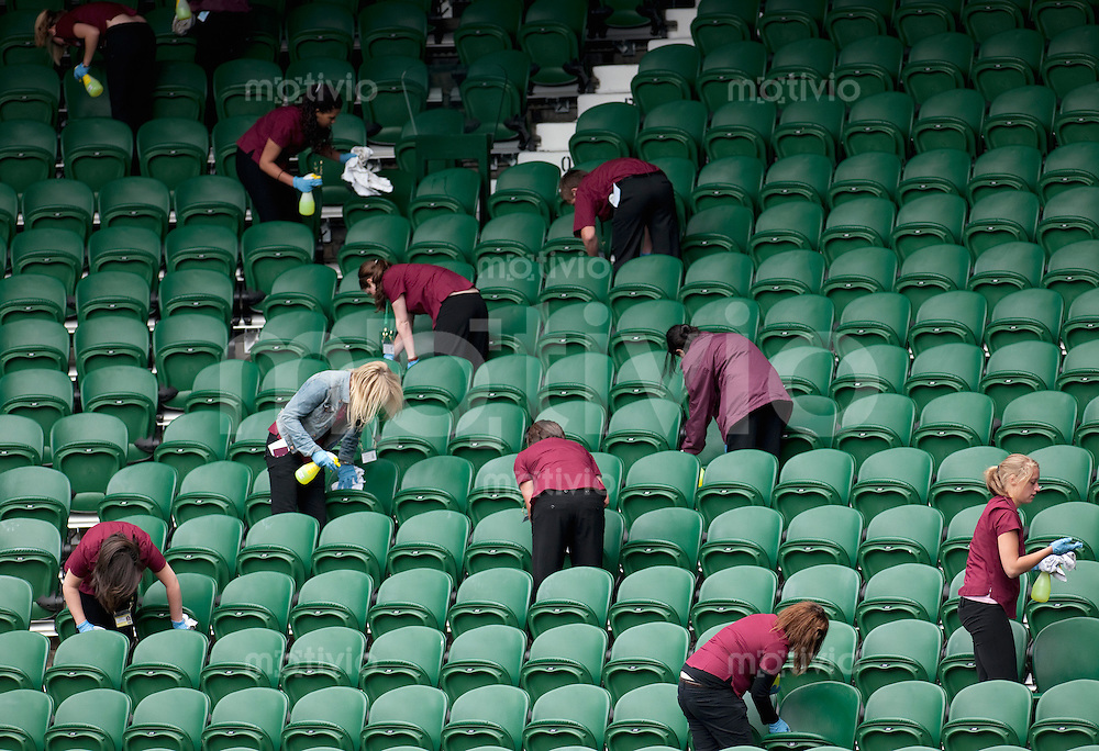 Staff cleans the spectators seats on Centre Court. Preparation for The Wimbledon Championships 2010 The All England Lawn Tennis & Croquet Club  Sunday Pre Championships Sunday 20/06/2010