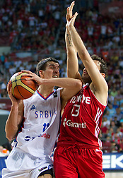 Marko Keselj of Serbia vs Ender Arslan of Turkey during the second semifinal basketball match between National teams of Serbia and Turkey at 2010 FIBA World Championships on September 11, 2010 at the Sinan Erdem Dome in Istanbul, Turkey. Turkey defeated Serbia 83 - 82 and qualified to finals.  (Photo By Vid Ponikvar / Sportida.com)