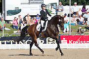 Jennifer Hoffmann - Florentinus V<br /> FEI World Breeding Dressage Championships for Young Horses 2012<br /> © DigiShots