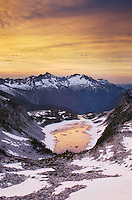 Sunrise over Forbidden and Boston Peaks from Hidden Lake Peak, North Cascades Washington