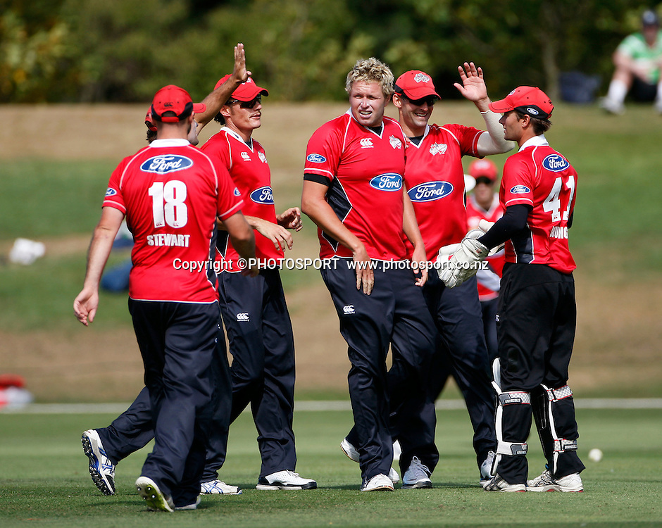 Canterbury bowler Mitchell Claydon is congratulated by team mates. Canterbury Wizards v Auckland Aces in the One Day Competition, Preliminary Semi Final. QEII Park, Christchurch, New Zealand. Sunday, 06 February 2011. Joseph Johnson / PHOTOSPORT.