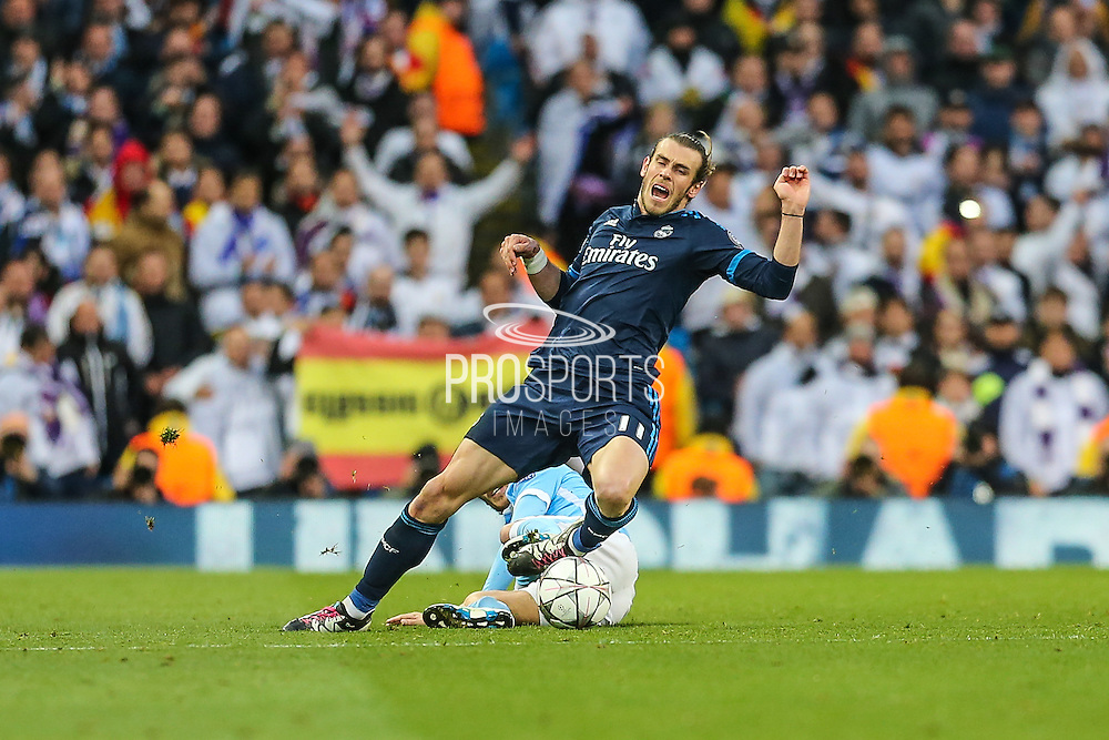 Manchester City's David Silva brings down Real Madrid's Gareth Bale during the Champions League match between Manchester City and Real Madrid at the Etihad Stadium, Manchester, England on 26 April 2016. Photo by Shane Healey.
