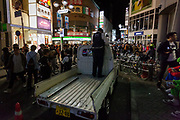 Japanese police officers guard a small truck that was overturned during drunken street celebrations during Halloween in Shibuya, Tokyo, Japan. Sunday morning October 28th 2018