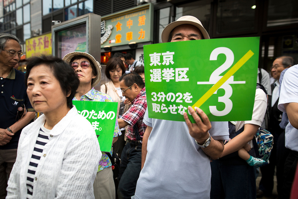 TOKYO, JAPAN - JULY 6 : Supporters watch the campaign speech of Toshio Ogawa, a candidate of Democratic Party of Japan (DPJ) during the Upper House election campaign outside of Machiya Station, Tokyo prefecture, Japan, on July 6, 2016. (Photo by Richard Atrero de Guzman/NUR Photo)