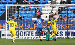 Wes Thomas of Oxford United scores his sides second goal of the game past Jonathan Bond of Peterborough United - Mandatory by-line: Joe Dent/JMP - 30/09/2017 - FOOTBALL - ABAX Stadium - Peterborough, England - Peterborough United v Oxford United - Sky Bet League One