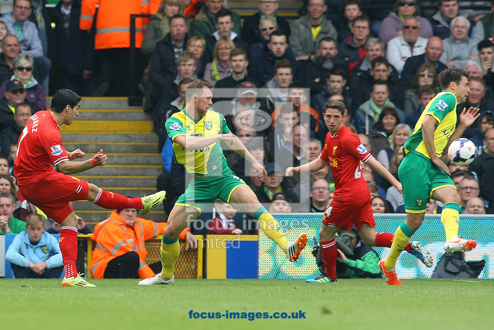 Luis Su&aacute;rez of Liverpool has a shot on goal during the Barclays Premier League match at Carrow Road, Norwich<br /> Picture by Paul Chesterton/Focus Images Ltd +44 7904 640267<br /> 20/04/2014