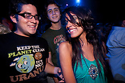 PRETTY FEMALE BLACK LONG HAIR WITH TWO MALES ONE IN WITTY LOGO T SHIRT URANUS