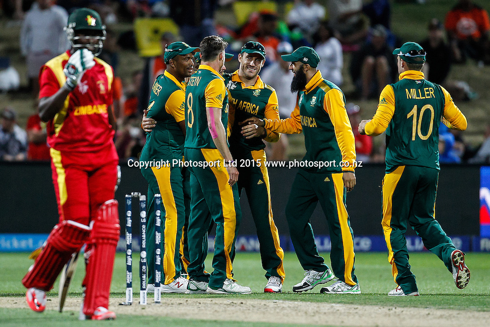 South Africa celebrate the wicket of Zimbabwe's Elton Chigumbura during the ICC Cricket World Cup match - South Africa v Zimbabwe at Seddon Park, Hamilton, New Zealand on Sunday 15 February 2015.  Photo:  Bruce Lim / www.photosport.co.nz