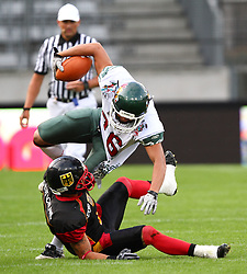 08.07.2011, Tivoli Stadion, Innsbruck, AUT, American Football WM 2011, Group A, Germany (GER) vs Mexico (MEX), im Bild Salazar Heriberto (Mexico, #86, K, WR) got stopped by Leonard Greene (Germany, #7, DB)  // during the American Football World Championship 2011 Group A game, Germany vs Mexico, at Tivoli Stadion, Innsbruck, 2011-07-08, EXPA Pictures © 2011, PhotoCredit: EXPA/ T. Haumer