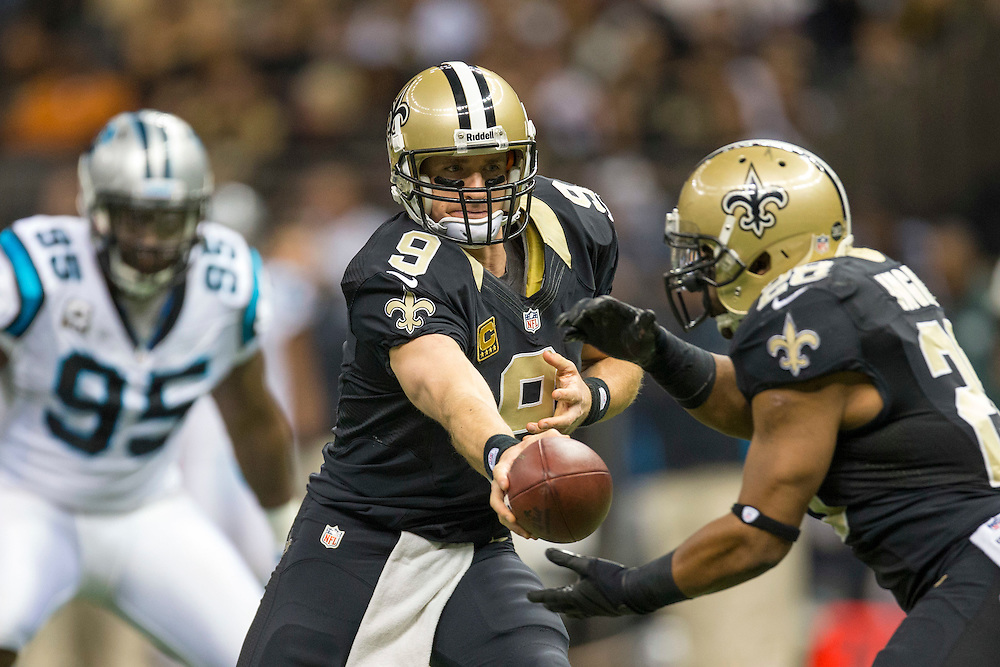 NEW ORLEANS, LA - DECEMBER 30:  Drew Brees #9 of the New Orleans Saints makes a handoff against the Carolina Panthers at Mercedes-Benz Superdome on December 30, 2012 in New Orleans, Louisiana.  The Panthers defeated the Saints 44-38.  (Photo by Wesley Hitt/Getty Images) *** Local Caption *** Drew Brees
