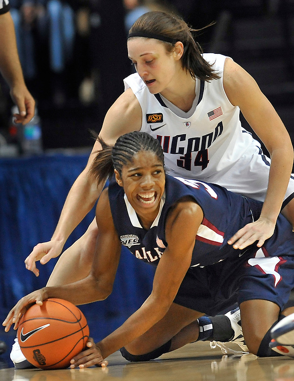 Connecticut's Kelly Faris, top, pressures Fairleigh Dickinson's Danielle Pankey, bottom, in the first half of an NCAA college basketball game in Storrs, Conn., Friday, Nov. 25, 2011. (AP Photo/Jessica Hill)