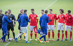 WREXHAM, WALES - Thursday, November 10, 2016: Wales players shake hands with Greece players during the UEFA European Under-19 Championship Qualifying Round Group 6 match at the Racecourse Ground. (Pic by Gavin Trafford/Propaganda)
