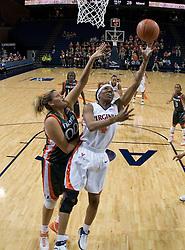 Virginia Cavaliers Center Siedah Williams (4) shoots around Miami Hurricanes center Amy Audibert (00).  The University of Virginia Cavaliers defeated the Miami Hurricanes Women's Basketball Team 73-60 at the John Paul Jones Arena in Charlottesville, VA on February 4, 2007.