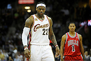 Apr 19, 2010; Cleveland, OH, USA; Cleveland Cavaliers forward LeBron James (23) and Chicago Bulls guard Derrick Rose (1) during the first period in game two in the first round of the 2010 NBA playoffs at Quicken Loans Arena. Mandatory Credit: Jason Miller-US PRESSWIRE