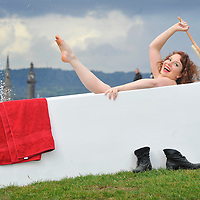 EDINBURGH, UK - 18th August 2010:  Australian Cabaret Artist Isabel Hertaeg takes a bath on top of Calton Hill in Edinburgh to raise awareness and funds for breast cancer research.  Isabel will be performing during the Edinbrugh Festival at her show La Petite Mort - The Orgasm an exploration into love, science, hormones, intimacy and hysteria.  (Photograph: Callum Bennetts/MAVERICK)