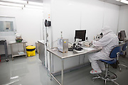 An employee works in a clean room at Exelis Inc. in Rochester, New York on September 10, 2014. Exelis is an aerospace and defense company, and employs numerous former Kodak workers in its Rochester facility.