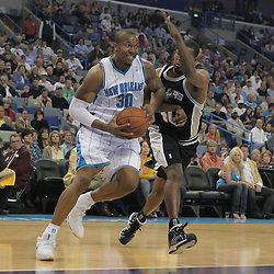 29 March 2009: New Orleans Hornets forward David West (30) drives past San Antonio Spurs center Kurt Thomas (40) during a 90-86 victory by the New Orleans Hornets over Southwestern Division rivals the San Antonio Spurs at the New Orleans Arena in New Orleans, Louisiana.