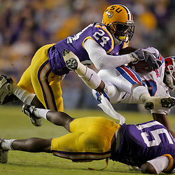 Nov 14, 2009; Baton Rouge, LA, USA;  Louisiana Tech Bulldogs wide receiver Phillip Livas (6) is up ended by LSU Tigers defenders cornerback Brandon Taylor (15) and running back Patrick Lipoma (24) during the first quarter at Tiger Stadium.  Mandatory Credit: Derick E. Hingle-US PRESSWIRE