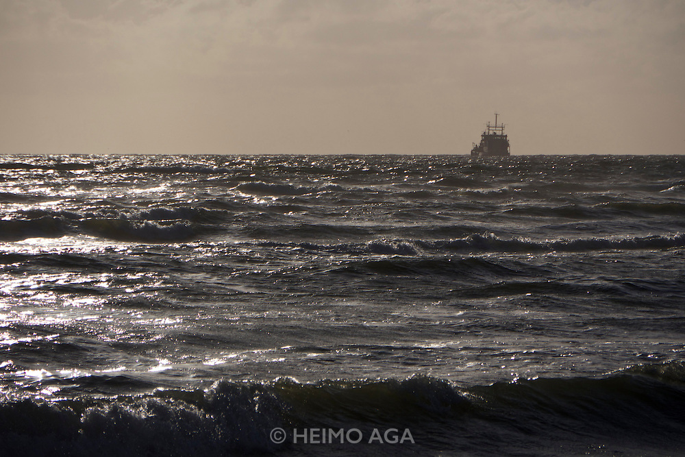 Sylt, Germany. A ship seen from Hörnum-Odde, Sylt's Southern tip.
