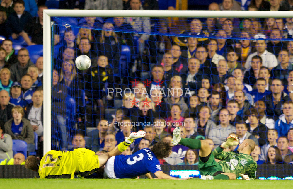 LIVERPOOL, ENGLAND - Wednesday, August 24, 2011: Everton's Jan Mucha and Leighton Baines are beaten by Sheffield United's Richard Cresswell for the first goal during the Football League Cup 2nd Round match at Goodison Park. (Pic by Dave Kendall/Propaganda)