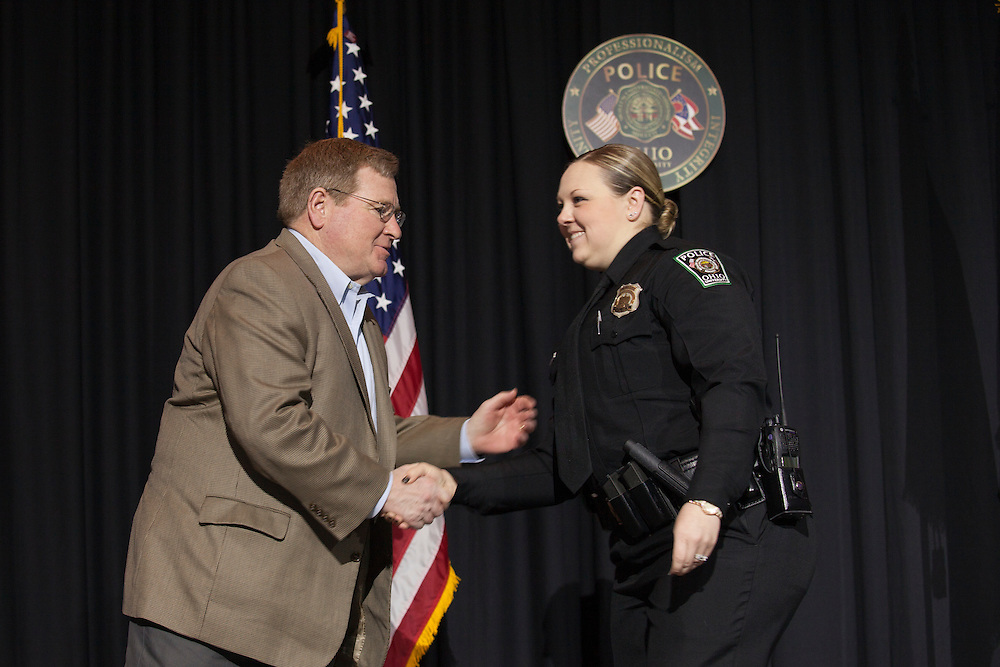 Ohio University vice president for Finance and Administration Steven Golding shakes hands with an award recipient at the Badge Pinning and Employee Recognition Ceremony on Monday, February 8, 2016. Photo by Kaitlin Owens