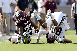 UCLA tight end Austin Roberts (88) losses his helmet after he collided with Texas A&M's defensive back Armani Watts (23) while fighting for a pass during the third quarter of an NCAA college football game Saturday, Sept. 3, 2016, in College Station, Texas. (AP Photo/Sam Craft)