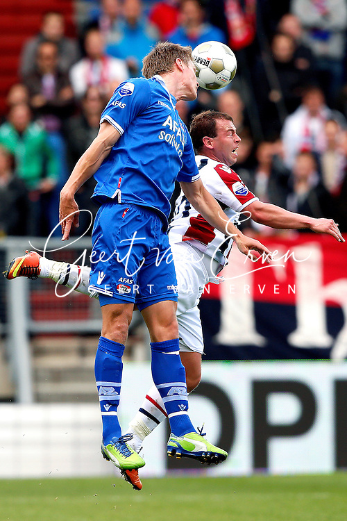 Onderwerp/Subject: Willem II - AZ Alkmaar - Eredivisie<br /> Reklame:  <br /> Club/Team/Country: <br /> Seizoen/Season: 2012/2013<br /> FOTO/PHOTO: Nicky HOFS ( Nick HOFS ) (R) of Willem II in duel with Viktor ELM (L) of AZ Alkmaar. (Photo by PICS UNITED)<br /> <br /> Trefwoorden/Keywords: <br /> #04 $94 &plusmn;1355244121349<br /> Photo- &amp; Copyrights &copy; PICS UNITED <br /> P.O. Box 7164 - 5605 BE  EINDHOVEN (THE NETHERLANDS) <br /> Phone +31 (0)40 296 28 00 <br /> Fax +31 (0) 40 248 47 43 <br /> http://www.pics-united.com <br /> e-mail : sales@pics-united.com (If you would like to raise any issues regarding any aspects of products / service of PICS UNITED) or <br /> e-mail : sales@pics-united.com   <br /> <br /> ATTENTIE: <br /> Publicatie ook bij aanbieding door derden is slechts toegestaan na verkregen toestemming van Pics United. <br /> VOLLEDIGE NAAMSVERMELDING IS VERPLICHT! (&copy; PICS UNITED/Naam Fotograaf, zie veld 4 van de bestandsinfo 'credits') <br /> ATTENTION:  <br /> &copy; Pics United. Reproduction/publication of this photo by any parties is only permitted after authorisation is sought and obtained from  PICS UNITED- THE NETHERLANDS