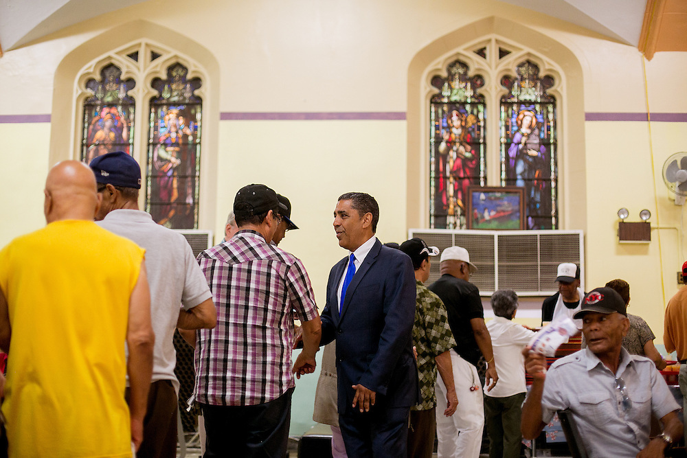 NEW YORK, NY - JUNE 28, 2016: Congressional candidate and New York State Senator Adriano Espaillat greets residents at S.T.A.R at 650 W 187th Street in New York, New York. CREDIT: Sam Hodgson for The New York Times.