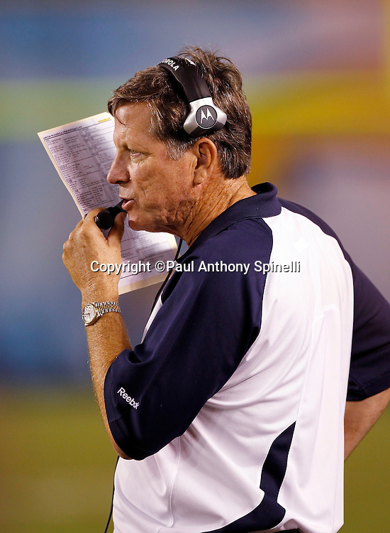 San Diego Chargers Head Coach Norv Turner talks on his headsets during a NFL week 1 preseason football game against the Chicago Bears, Saturday, August 14, 2010 in San Diego, California. The Chargers won the game 25-10. (©Paul Anthony Spinelli)